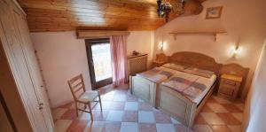 Postel nebo postele na pokoji v ubytování Appartamenti Bait Carosello