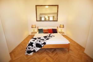 Postel nebo postele na pokoji v ubytování Fano Apartments Old Town Prague