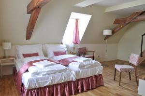 A bed or beds in a room at Penzion Lípa