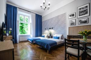 A bed or beds in a room at Bentis Luxury Apartments