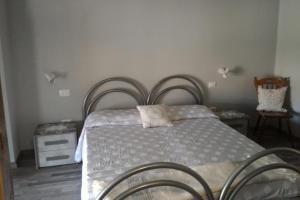 Letto o letti in una camera di Corona Bed & Breakfast