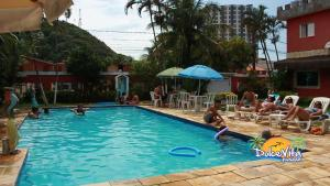 The swimming pool at or near Pousada Dolce Vita