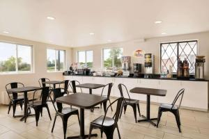 A restaurant or other place to eat at Super 8 by Wyndham Portland/Westbrook Area