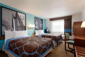 A bed or beds in a room at Super 8 by Wyndham Portland/Westbrook Area