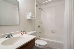 A bathroom at Super 8 by Wyndham Portland/Westbrook Area