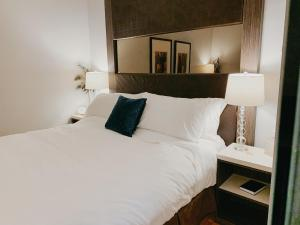 A bed or beds in a room at St. James' Gate, Boutique Hotel
