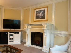 A television and/or entertainment center at The Hewitt Wellington Hotel