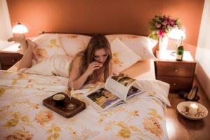 Postel nebo postele na pokoji v ubytování Apartmány Kolonáda
