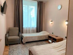 Кровать или кровати в номере Gostinnyj Dvor