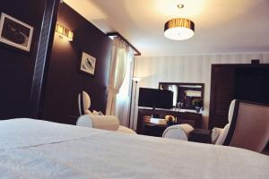 A bed or beds in a room at Hotel Per Astra
