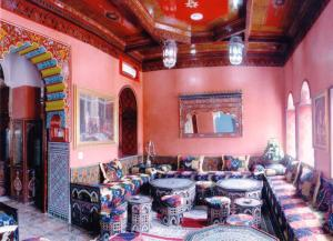A restaurant or other place to eat at Moroccan House
