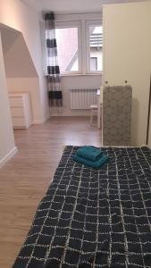 Łóżko lub łóżka w pokoju w obiekcie Kuchciak Apartments