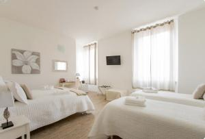A bed or beds in a room at Affittacamere Casa Dane'