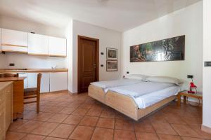 Postel nebo postele na pokoji v ubytování Chalet Olta