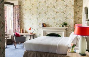 A bed or beds in a room at Pendley Manor