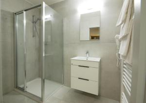 A bathroom at Adeba Hotel