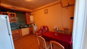 A kitchen or kitchenette at Гостевой Дом Александрия