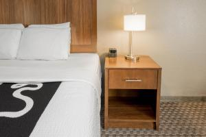 A bed or beds in a room at La Quinta by Wyndham Fort Worth Eastchase