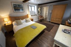 A bed or beds in a room at Wheelwrights Arms Country Inn & Pub