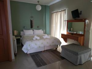 Ένα ή περισσότερα κρεβάτια σε δωμάτιο στο Villa Muses