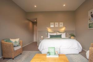 A bed or beds in a room at Dunluce Boutique Accomodation