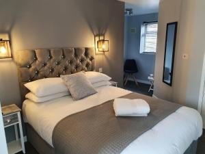 A bed or beds in a room at The Old Bell