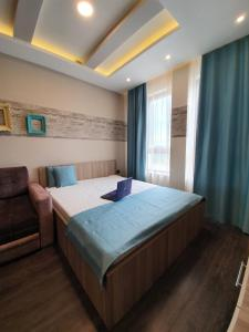 Krevet ili kreveti u jedinici u okviru objekta Marrilux apartments-MILMARI RESORT