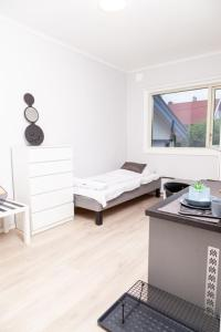 A bed or beds in a room at EasyRoom Oslo Budget - Free parking