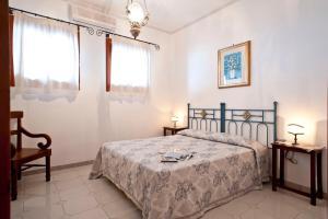 A bed or beds in a room at Villa La Roccia - Arienzo