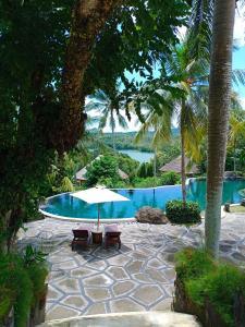 The swimming pool at or near Taman Wana Resort