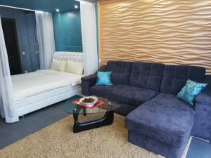 Гостиная зона в Luxury Apartment in Baikal Hill Residence