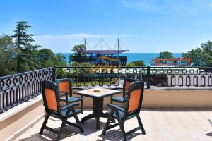 A balcony or terrace at Sea View Rental Front Beach