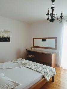 A bed or beds in a room at Villa Beba - Apartments