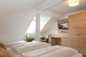 Ein Bett oder Betten in einem Zimmer der Unterkunft Ferienpension Seeblick