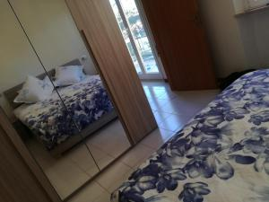 A bed or beds in a room at Diamond appartament