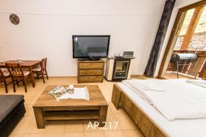 A television and/or entertainment center at Fatrapark 2, Ap217