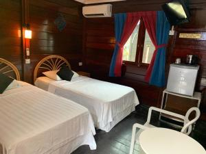 A bed or beds in a room at Nipah Bay Villa