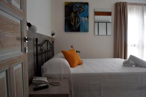 A bed or beds in a room at Residenza Al Castello