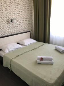 Кровать или кровати в номере Stella