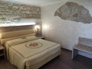 A bed or beds in a room at Hotel Internazionale
