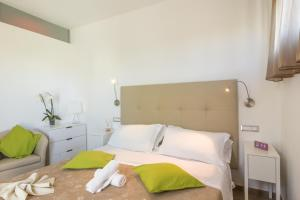 A bed or beds in a room at SeaPark SPA Resort
