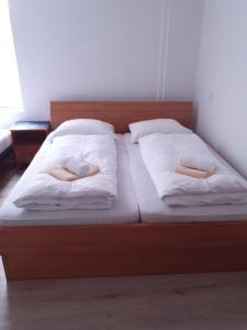 Postelja oz. postelje v sobi nastanitve Guesthouse Osvald