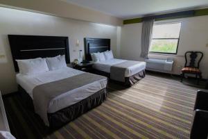 Cama o camas de una habitación en Best Western Hotel Plaza Matamoros