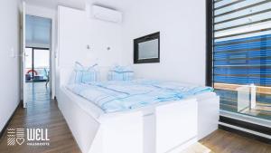 Ein Bett oder Betten in einem Zimmer der Unterkunft WELL Hausboote