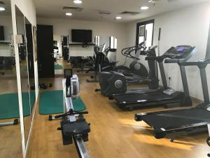 The fitness center and/or fitness facilities at Family & Bachelor Rooms