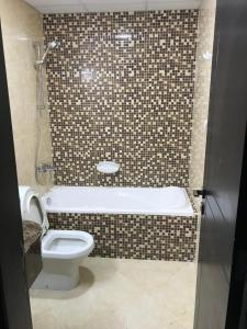 A bathroom at Family & Bachelor Rooms