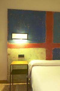 Cama o camas de una habitación en Hotel Santa Cristina Petit Spa