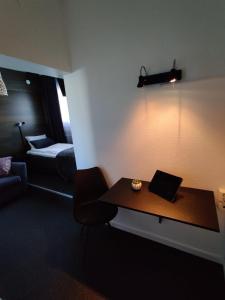 En tv och/eller ett underhållningssystem på CarlstadCity Hostel
