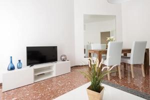 TV o dispositivi per l'intrattenimento presso iFlat Glowing apartment in Balduina