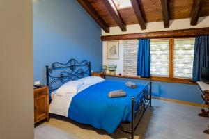 A bed or beds in a room at Isola Di Wight